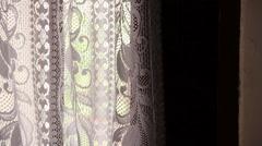 Creepy curtain look through Stock Footage