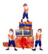 Three posing gnomes  with gift boxes - stock photo