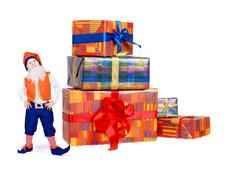 Little funny gnome with gift boxes - stock photo