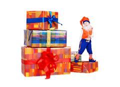 Little funny gnome dancing on gift boxes - stock photo