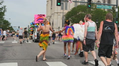 People dancing having fun walking marching  during gay pride parade Stock Footage