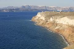 Indented sea coast of Santorini island, Greece. - stock photo