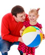 Daddy plays with his beloved daughter - stock photo