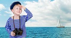 Little sailor with binoculars - stock photo