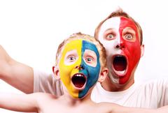 Portrait two screaming fans Poland Ukraine Stock Photos