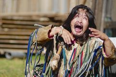 Mongolian shaman performs a ritual in Ulan Bator, Mongolia. - stock photo