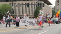 Mormons LDS church group in gay pride parade Denver, Colorao religion change - stock footage