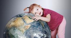 Little girl gently hugs the Earth globe Stock Photos