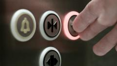 Man pushes a button opening elevator doors. Close up - stock footage
