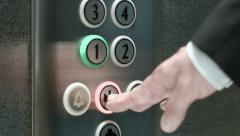 Man presses a button the first floor and a button closing elevator doors - stock footage