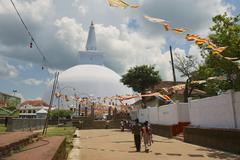 People go to the Ruwanwelisaya stupa in Anuradhapura, Sri Lanka. - stock photo
