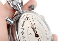Close up view on the hands of stop watch - stock photo