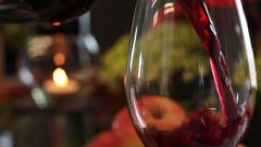 Wine Glass, Pouring, Fruit, Candle, Flowers in Background - stock footage