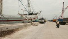 Walk up gangway of old wooden ship, pinisi vessel at Sunda Kelapa Stock Footage