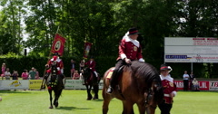 Horsemen of Netherlands guilds parading with standard Stock Footage