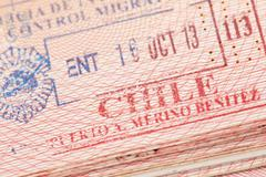 Passport page with Chile immigration control entry stamp. Stock Photos