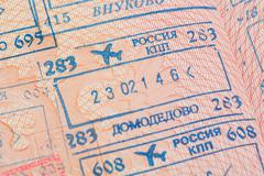 Passport page with the Domodedovo and Vnukovo immigration control stamps. - stock photo