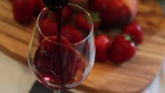 Wine Glass, Pouring, Fruit and Cutting Board in Background - stock footage