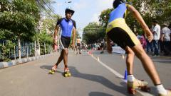 City children rollerskating on closed Street, having fun - editorial footage. Stock Footage