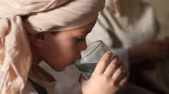 Child Eats Passover Dinner in Biblical Reenactment Stock Footage