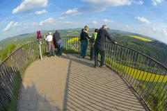 Tourists enjoy panoramic view from Bastei, Rathen, Germany. Stock Photos