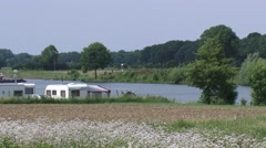 Campground, caravans on the bank of the river Meuse + zoom out Stock Footage
