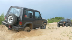 The rope pulling a jeep from the sand Stock Footage
