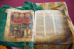 Ancient Bible in Amharic language in the church of Our Lady Mary of Zion, the - stock photo