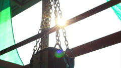Muay Thai Punch Bag, Chain, Sunlight And Lens Flare 2 Shots Stock Footage