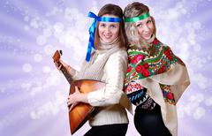 Two russian beauty girls with folk attributes - stock photo