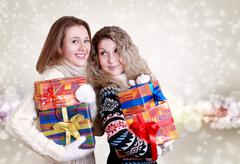 Happy girlfriends with christmas presents - stock photo