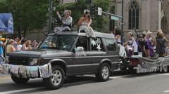 Float in Gay pride parade with drag queen performers in Denver, Colorado Stock Footage
