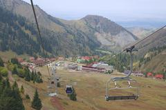 View to the Shymbulak ski station from the cable car in Almaty, Kazakhstan. Stock Photos