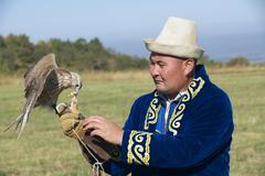 Man feeds falcon, Almaty, Kazakhstan. Stock Photos