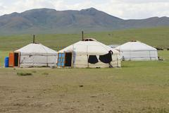 Three traditional Mongolian yurts in steppe, circa Harhorin, Mongolia. Stock Photos