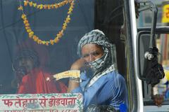 Passengers sit in the cabin of intercity bus, Mandawa, India. Stock Photos