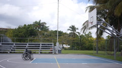 DISABLED-PARAPLEGIC: Empty wheelchair in basketball court Stock Footage