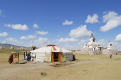 People visit Erdene Zuu monastery in Kharkhorin, Mongolia. - stock photo