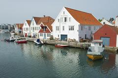 Exterior of the traditional wooden houses in Skudeneshavn, Norway. - stock photo