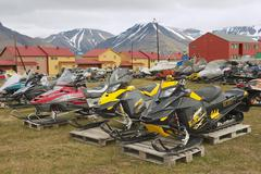 Snowmobiles parked for a short arctic summer in Longyearbyen, Norway. - stock photo
