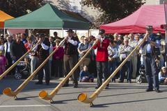 Men perform music with alpenhorns in Affoltern Im Emmental, Switzerland. Stock Photos