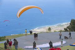 Paragliders ready to take-off, Reunion. - stock photo