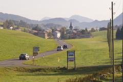 Cars pass by a countryside road, Affoltern im Emmental, Switzerland. Stock Photos