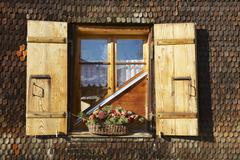 Exterior detail of the traditional Swiss chalet in Rougemont, Switzerland. - stock photo