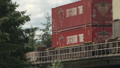 Railroad, freight train over swing bridge long lens, container train #3 Stock Footage