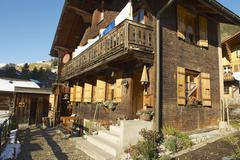 Exterior of the traditional Swiss chalet in Rougemont, Switzerland. Stock Photos