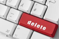 Red delete key on keyboard - stock photo