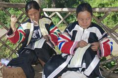 Women of the Black Lahu hill tribe do embroidery work. Stock Photos