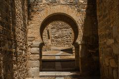 Arch in old European city - stock photo
