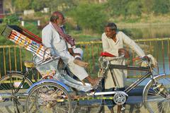 Rickshaws wait for passengers, Varanasi, India. Stock Photos